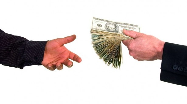 Business-man-handing-cash-to-another-person-loaning-money-via-Shutterstock-615x345